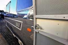 Airstream Tiny Home Kaufen Verkauf Wohnwagen Hochglanz poliert Aluminium restauriert Tür rechts