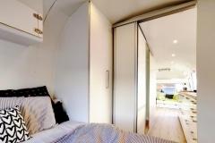 Airstream Tiny House Schlafzimmer Küche Bad Stauraum Schiebetüren LED Beleuchtung